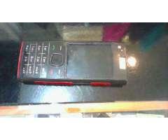 nokia x2 whatsapp y camara de 5 mp, sin tapa trasera con cargador
