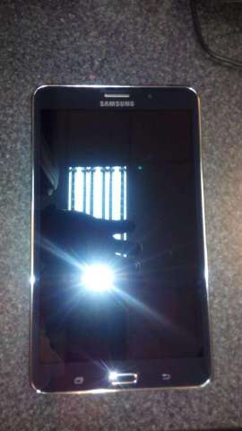 Teléfono y table Samsung galaxy tab 4 modelo smt 231